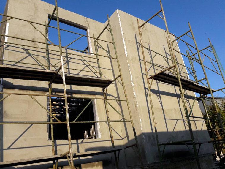 proiect de casa 130-088 la stadiul de aplicare masa de spaclu fatade